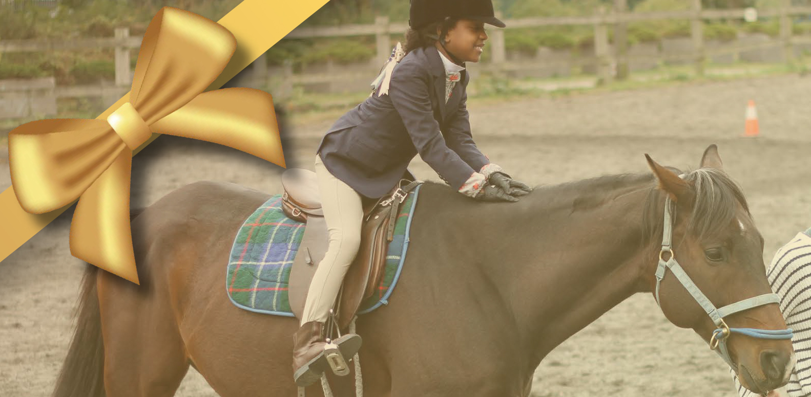 Therapeutic riding student Afiya on her horse, in two point position. Image has graphic element of a gold bow overlaying top left corner.